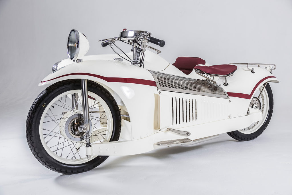 A 1930 Majestic is a must in any exhibit combining 'art' and 'motorcycle'! Designed by Georges Roy in Paris, the hub-center steered machine is a landmark of radical design. [O. DeVaulx]